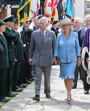 Camilla looks as charming and classic as ever in one of her signature jacket-and-skirt combos.