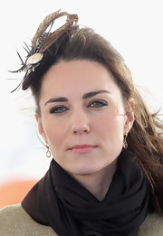 Kate Middleton added a dash of lip gloss to her classic look at the Trearddur Bay RNLI Lifeboat Station.