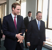 Prince William brightened up his dark suit with a magenta dotted tie for his visit to New Zealand.