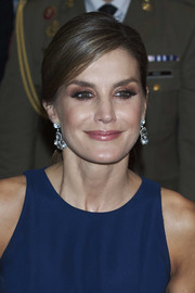 Queen Letizia of Spain went for a glam finish with a pair of blue topaz chandelier earrings by Yanes.