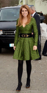 Princess Beatrice paired her pleated dress with opaque tights to beat the cold winter weather.
