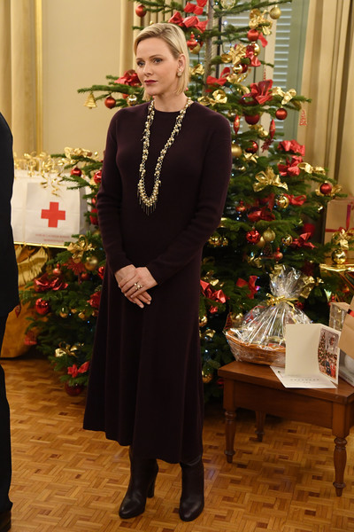 Charlene Wittstock attended the Christmas gifts distribution at La Croix Rouge in Monte Carlo wearing an aubergine sweater dress by Loro Piana.