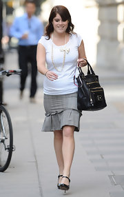 Princess Eugenie looked as classy as ever in her plaid skirt and leather tote bag.