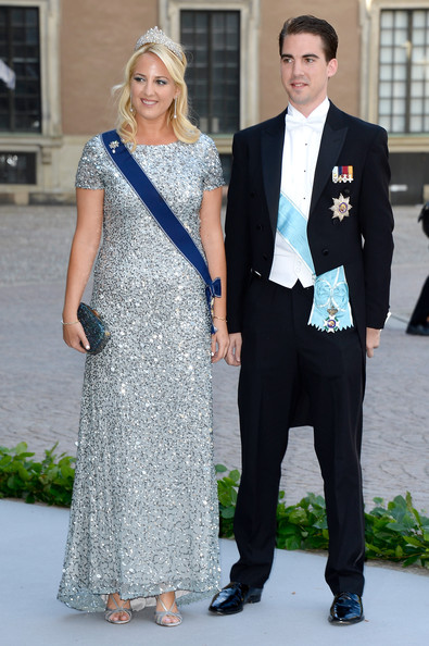 Princess Theodora Metallic Clutch [theodora of greece,christopher oneill,philippos,silvia,princess madeleine of sweden,suit,clothing,formal wear,fashion,dress,tuxedo,event,gown,outerwear,blazer,wedding of princess madeleine,wedding,greece,the royal palace,sweden]