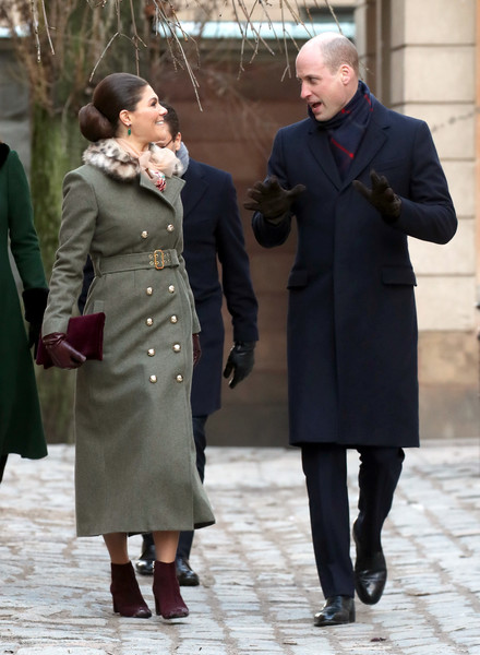 Princess Victoria Ankle Boots [coat,clothing,overcoat,standing,fashion,lady,trench coat,outerwear,interaction,gesture,duchess,sweden,norway,duchess of cambridge,stockholm,cambridge,streets,prince william,duke,victoria]