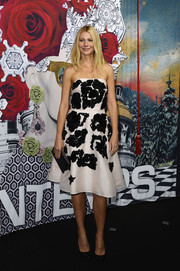 Gwyneth Paltrow looked captivating in a beaded black-and-white strapless dress by Prada during the Printemps Haussmann Christmas decoration launch.