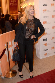 Shannon Tweed arrived at the premiere of 'Prisoners' carrying a two-way luxury tote.