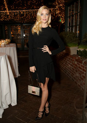 Jaime King styled her dress with chic black lace-up pumps by Bionda Castana.