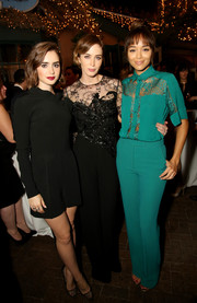 Lily Collins teamed her romper with edgy-chic black mesh pumps by Louboutin.
