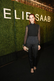 Jena Malone's tricolor striped Jimmy Choo clutch went flawlessly with her all-black outfit.