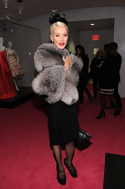 Daphne Guinness paired an opulent fur coat with black glittery maryjane wedges. The heels gave her glam look an avant-garde vibe.