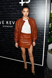Hailee Steinfeld matched her jacket with a rust-colored leather mini.