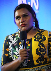 Mindy Kaling went for fun styling with a pair of silver triple-disc earrings at the 2019 Produced By Conference.