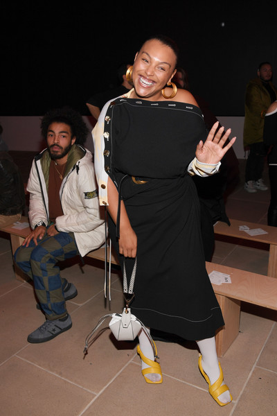 Paloma Elsesser rounded out her ensemble with a structured white leather wristlet.