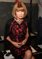 Anna Wintour showed off a multi-colored gemstone necklace.