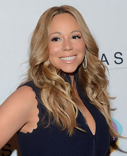 Mariah Carey a charity event for Project Canvas wearing her hair in long lightened layers.