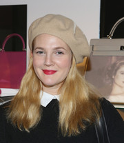 Drew Barrymore accessorized with a nude beret for a Parisian-chic look during Project Perpetual's inaugural auction.