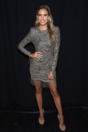 Renee Bargh was flapper-chic in a silver lace dress with a fringed hem during the 'Project Runway' fashion show.
