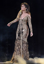 Jennifer Lopez looked like a dream at the Q'Viva concert in this feathered mermaid gown.