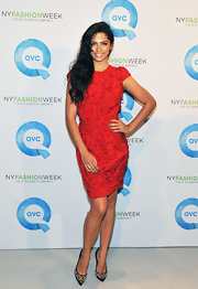 Camila Alves added a touch of dazzle to her red frock with gold embellished stilettos.