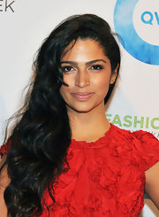 Camila Alves wore her ultra-long tresses in side-swept waves at QVC's 2012 fall fashion show.