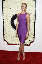 Stacy Keibler looked saucy at the QVC cocktail party in this purple backless bandage dress.