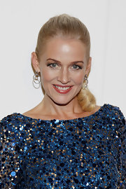 Penelope Ann Miller attended the QVC Red Carpet Cocktail Party wearing her hair in a sleek curly ponytail.