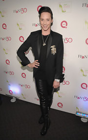 Johnny rocks a pair of leather leggings with zip up boots and a black blazer with a Chanel pin.