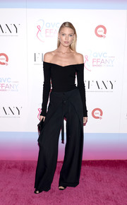 Martha Hunt chose a pair of black wide-leg pants by Proenza Schouler to finish off her outfit.