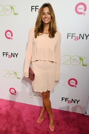 Kelly Bensimon looked breezy in a textured pink mini skirt and a matching top during the FFANY Shoes on Sale event.