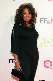 Star Jones went for casual sophistication at the FFANY Shoes on Sale event in a loose black blouse with split sleeves.