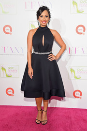 Cheryl Burke cut a shapely silhouette in her fit-and-flare, keyhole-cutout dress during the FFANY Shoes on Sale event.