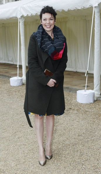 Olivia Colman stuck to a classic English favorite when she sported this black wool coat.