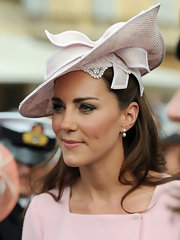 Kate Middleton added a warm pearlescent pink lipstick to complete her pastel ensemble.
