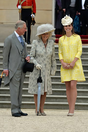 Kate Middleton chose a summery yellow coat for her look at the Garden Party hosted by Queen Elizabeth.