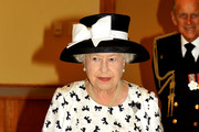Queen Elizabeth II Wears a Bow Print Dress