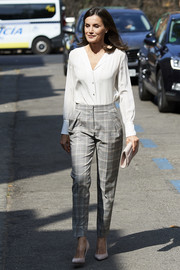 Queen Letizia of Spain was casual-chic in a white button-down shirt at the AECC meeting.