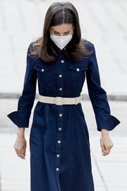 Queen Letizia of Spain paired  white leather belt with a blue denim shirtdress for a meeting in Madrid.