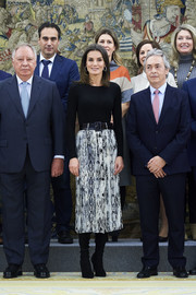 Queen Letizia of Spain attended audiences at Zarzuela Palace wearing a fitted black sweater by Hugo Boss.