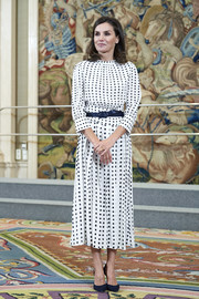 Queen Letizia of Spain attended audiences at Zarzuela Palace wearing a printed midi dress by Massimo Dutti.