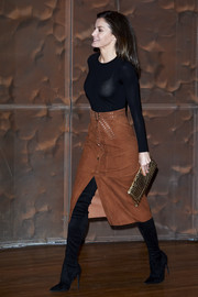 Queen Letizia of Spain paired a studded brown suede skirt by Uterqüe with a fitted black sweater for a cancer forum in Madrid.