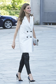 Queen Letizia of Spain showed off her cool-girl side with this white Massimo Dutti vest teamed with black leather leggings while attending Famelab 2017.