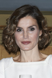 Queen Letizia of Spain styled her hair into a curled-out bob for the Luis Carandell Journalism Award.