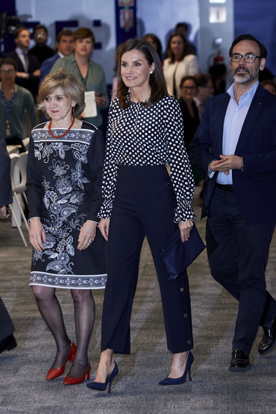 Queen Letizia of Spain teamed navy Magrit pumps with black slacks and a polka-dot blouse for the Medios de Comunicacion y Salud Mental event.