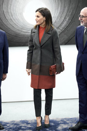 Queen Letizia of Spain teamed a color-block coat by Hugo Boss with black trousers for the Foundation Against Drugs meeting.