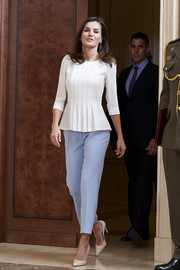 Queen Letizia of Spain donned a white peplum top with a pleated front to attend several audiences at Zarzuela Palace.