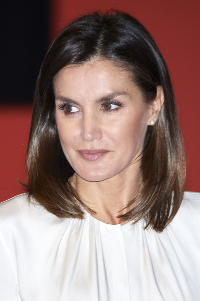 Queen Letizia of Spain Pearl Studs [the centenary of the school of nursing,hair,eyebrow,human hair color,beauty,hairstyle,fashion model,chin,forehead,fashion,layered hair,queen,letizia,letizia attends,cruz roja,centenary,of the central hospital,spain,center,school of nursing]
