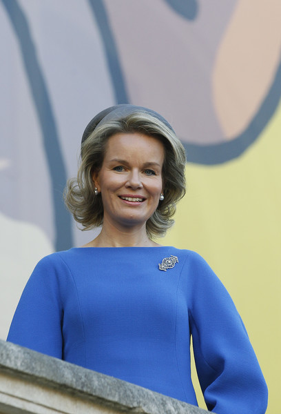 Queen Mathilde of Belgium Diamond Brooch [mathilde of belgium visits the herge exhibition at le grand palais,poster,photos,tintin,blue,cobalt blue,electric blue,smile,blond,shoulder,happy,mathilde of belgium,queen,character,front,paris,exhibition]
