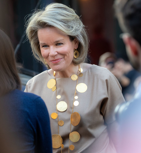 Queen Mathilde of Belgium Gold Statement Necklace [hair,blond,lady,hairstyle,yellow,smile,fashion accessory,style,queen,mathilde of belgium,brussels,saint-gorik hall,belgium,mathilde of belgium attends the global girls summit by plan international,plan international,global girls summit]