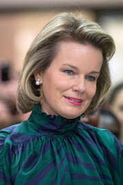 Queen Mathilde of Belgium visited the Cemavie Medical Center wearing her hair in a perfectly styled bob.